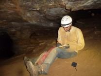 Field work in a cave in Southern Indiana. I am jotting notes at the beginning of the sampling trip.