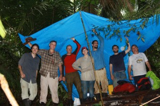 A group photo in Brazil. We are under a tent we pitched to protect our instruments in a down pour.