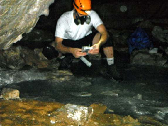Sampling the air of Cueva de Villa Luz, a sulfidic cave. I am wearing a gas mask to protect myself from hydrogen sulfide in the air.